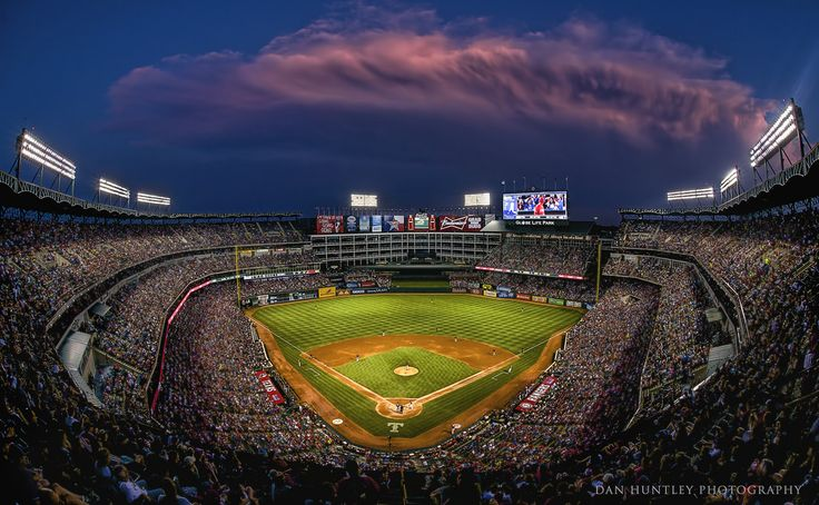 When going to a Rangers game I try to slip up to the upper deck behind home plate and grab a fish-eye shot. This night  I was going for a blue hour shot. When I arrived up top a huge thunder storm was moving in from the south. A nice dramatic touch to the image. By the way, this was the night of the Yu Darish 8 2/3 inning no-hitter. Fun night!