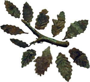 Leaves of oak Material: Bronze sheet with embossed veins Provenance: Sanctuary of Zeus at Dodona (excavations by Konstantinos Karapanos) Date: ca. 300 BC Exhibition Location: Room 36, Case 6, inv. no Καρ. 303,312, National Archaeological Museum.