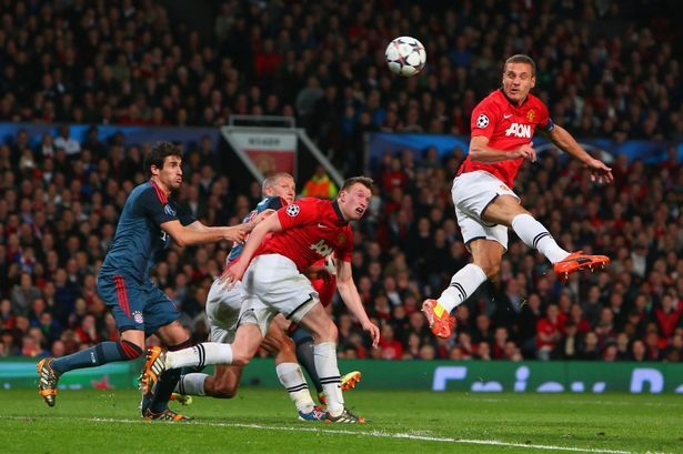 Nemanja Vidic jumps highest to open the scoring