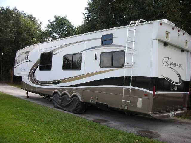 2008 Used K-Z Manufacturing Escalade 41CKS Toy Hauler in Florida FL.Recreational Vehicle, rv, 2008 K-Z Manufacturing Escalade 41CKS, 2008, KZ Escalade Sportster, 41 CKS, 3 A/Cs with heat pump, convection microwave, King size bed with upgrade mattress, Onan 5.5 generator, disc brakes, thermo-pane windows, auto satellite dish and separate portable satellite dish, roll-out tray, battery upgrade, dark cherry wood, 12 cu/ft side-by side refrigerator with brand new cooling unit, Corian counters…