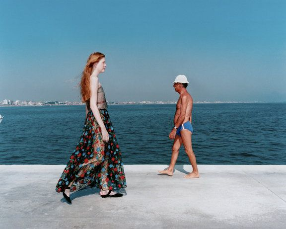 Martin Parr This image not only calls a difference between the young, pale girl and heavily tanned older looking man, but also gives a sense of coming and going. Perhaps that is how pale the man was when when he arrived to the beach and perhaps that is how tanned the girl will be when she leaves.