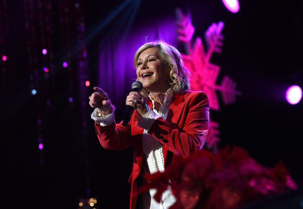 Olivia Newton-John Photos Photos - Olivia Newton John performs at the 85th annual Hollywood Christmas parade on Hollywood Boulevard in Hollywood, on November 27, 2016. / AFP / CHRIS DELMAS - Olivia Newton John Performs at the Hollywood Christmas Parade