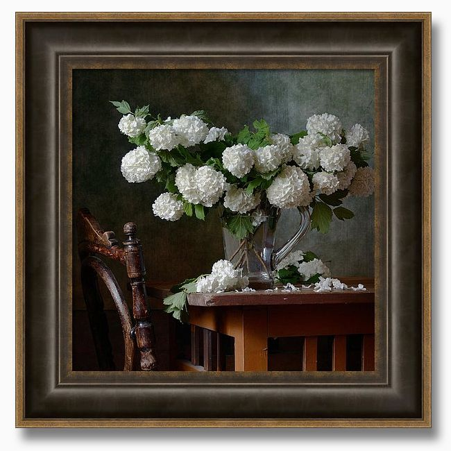 Snowball Flowers - - Still life with bunches of snowball flowers in glass vase on a brown retro table and with vintage old chair near it. by Nikolay Panov - - https://pixels.com/products/snowball-flowers-nikolay-panov-framed-print.html