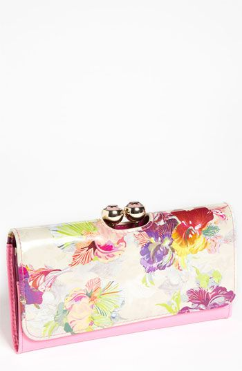 CeciStyle v139: HOLDING PATTERN: Switch out your monochrome wallet just in time for spring with this Treasured Orchid matinee wallet from Ted Baker London ($180, nordstrom.com).