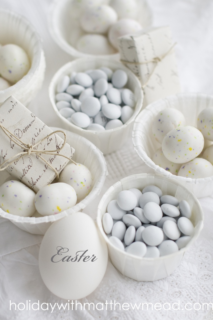 All white candies, eggs and packages make charming contents for baskets. Monogram eggs with rub on litters.