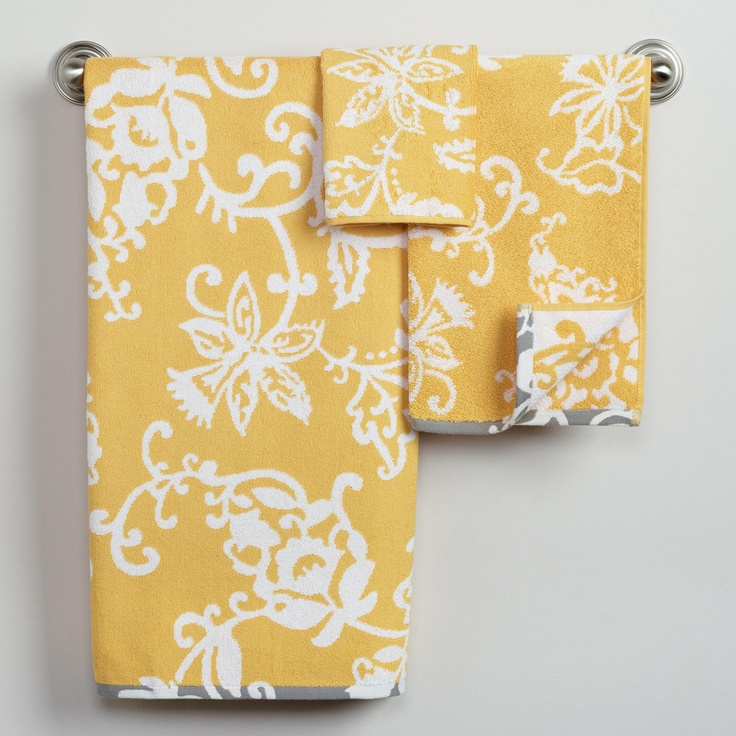 Yellow, white  grey accent towels. :) perfect for the yellow bathroom.