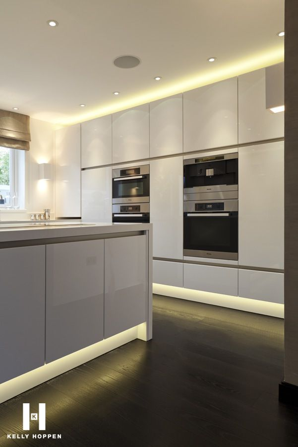 glamorous lighting - all white kitchen with floor to ceiling cupboards - Kelly Hoppen for Regal Homes @ Circus Road www.kellyhoppen.com www.regal-homes.co.uk