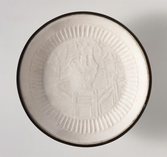 Dish (Pan) with Garden Landscape China, Hebei Province, Quyang County, late Jin dynasty or early Yuan dynasty, about 1200-1300 Furnishings; Serviceware Ding ware, molded stoneware with impressed decoration, white glaze, and banded metal rim Height: 9/10 (2.2 cm); Diameter: 5 1/2 in. (14 cm) Gift of Nasli M. Heeramaneck (M.73.48.106)