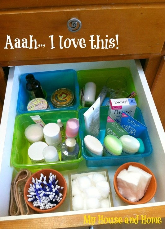 Organized bathroom drawer with dollar store bins and flower pots!