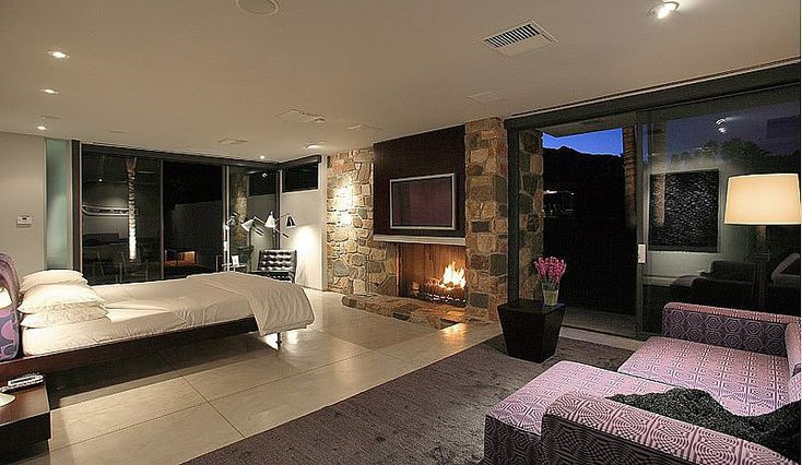 Celebrity Bedrooms   After selling his Malibu home for $17.35 million, Leonardo DiCaprio bought this Palm Springs pad for a mere $5.23 million. Designed by famed architect Donald Wexler in 1963, the large master bedroom includes a fireplace and, of course, views of the San Jacinto Mountains.