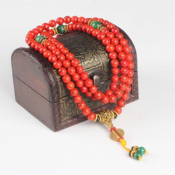 This gorgeous coral, gold, and jade mala necklace represents the orange, or sacral chakra. This chakra relates to self-respect. Meditate on freedom, self-care, and creativity. Orange is the color of creativity and we should give ourselves the space to have creative time just for us. Use each bead to meditate, and repeat thoughts of peace, creativity, and respect.