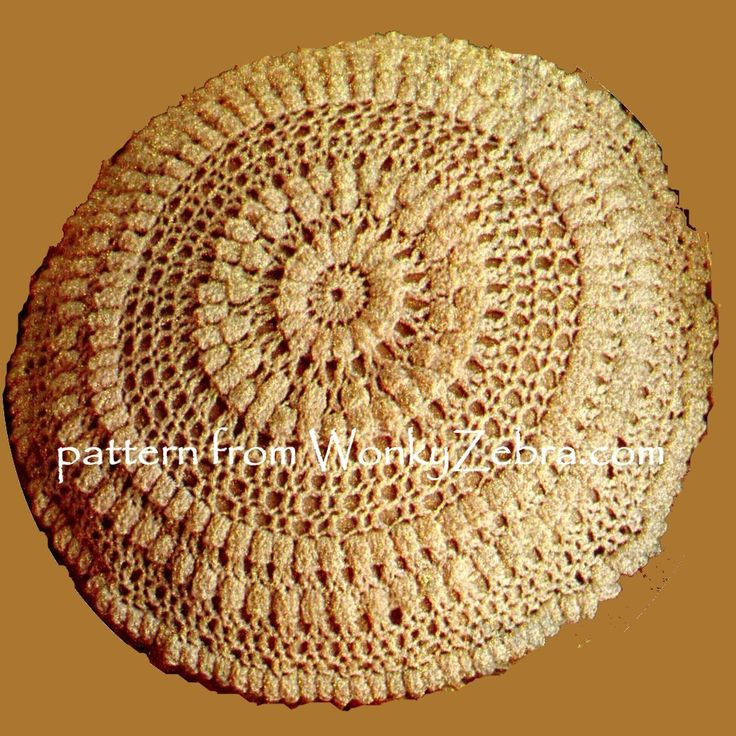WZ695 round crochet cushion in elegant cream. Keep with the Aran look, or use colourful oddments for a modern take. PDF pattern from WonkyZebra.com