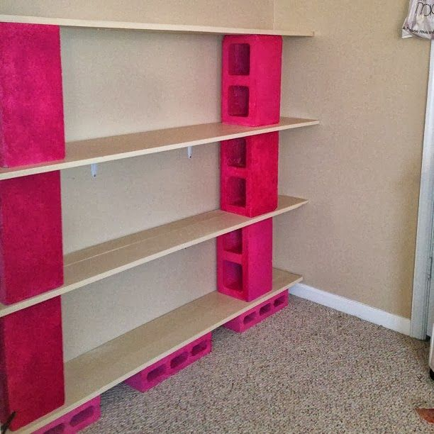 Now the fun begins, adding books to these diy shelves. Painted pink as you can never have enough of this color! Word to the wise, when paint...