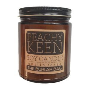 Peachy keen - a great scent of a perfectly fresh peach from a farmers market. Each candle is in a 9oz amber glass jar with a black metal lid. They have a 70  hour burn time and are made from all natural US soy beans. They are hand poured in Austin, Texas in small batches to ensure quality.Shipping is a flat $6 for as many candles as you want! 1 or 10!The candles are made by Josiah and Lauren - the crazy owners of The Burlap Bag! They are also for sale at our retail shop, The Burlap Bag, in…