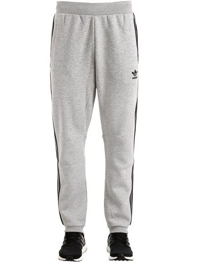 promo code 6b289 006f3 ADIDAS ORIGINALS, Curated cotton sweatpants, Grey, Luisaviaroma - Elastic  waistband . Ribbed cuffs at hem . Contrasting color stripes. Logo detail .