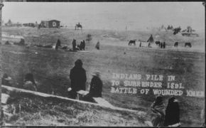 View of survivors of the Wounded Knee Massacre surrendering to the U.S ...