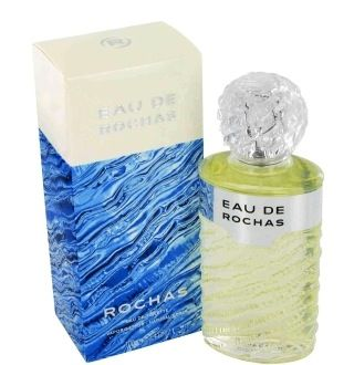 """Eau de Rochas was originally called """"Eau de Roche"""". Eau de Rochas is an amazing cascade of sparkling fruit and floral notes from the Mediterranean countries, such as mandarin, grapefruit or verbena. Mountain narcissus and wild rose mingle in a whirl of wild notes before blossoming on a deep background of ambre, cinnamon and sandalwood for a unique and effervescent aroma. Introduced in 1970. The bottle is shaped like rock crystal and nestled in a box clothed with the cool colors of a…"""