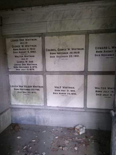 looking inside Walt Whitman family mausoleum and a collection of his books that have been placed within. Near his hometown of Camden New Jersey.