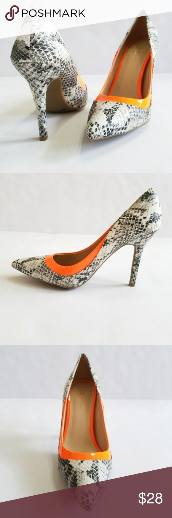 BCGGeneration Snakeskin & Neon Pumps Heels BRAND NEW! BCGGeneration Snakeskin & Neon Stripe Pumps size 6 1/2  Be prepared to get all the attention with these snakeskin print pointy toe pumps with an unexpected and edgy orange stripe. Style: Delliah.  4 inches heel Pre-owned. Excellent condition. Never worn. BCBGeneration Shoes Heels