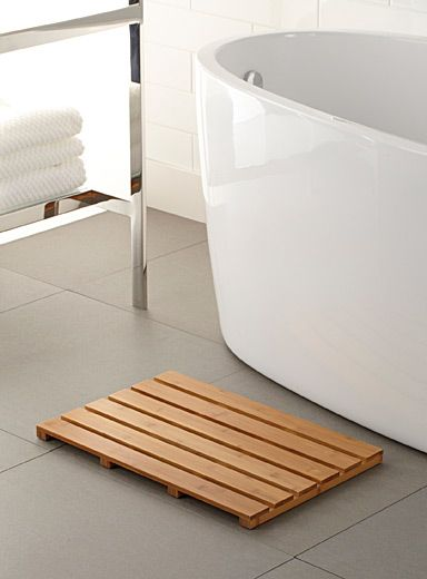 Exclusively from Simons Maison    - Minimalist bamboo strip mat for a natural and warm spa-like ambiance in the bathroom  - Rubber feets for cushioned contact with floor  - Durable handmade construction  - 36 x 54 cm