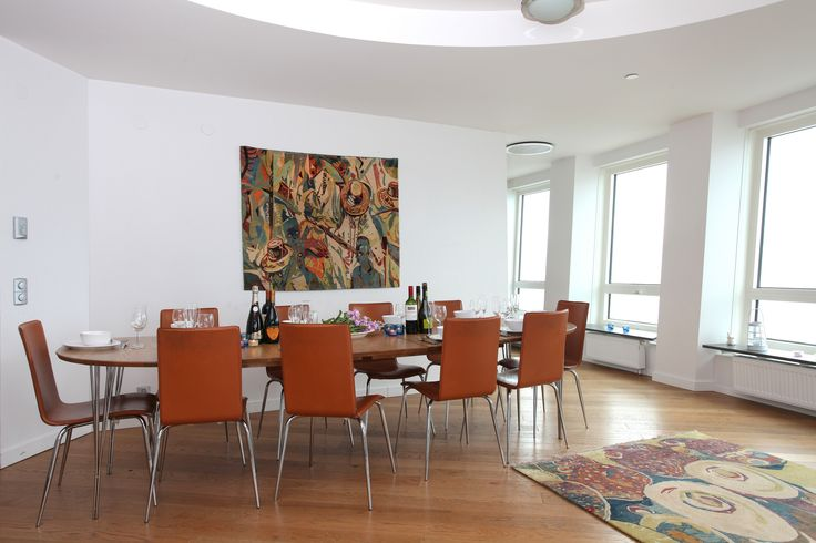 "Ehi Obinyan's rugs ""Eyo Festival"" and ""Market Scene"" provide the right setting for the dining area. . #interiordesign #homedecor #rug Check out our website for more of our collection http://africaonthefloor.com/"