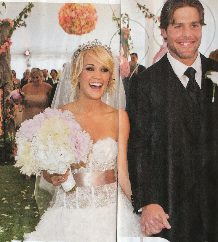 Carrie Underwood married Mike Fisher on July 10th, 2010 wearing a Monique Lhuillier gown.