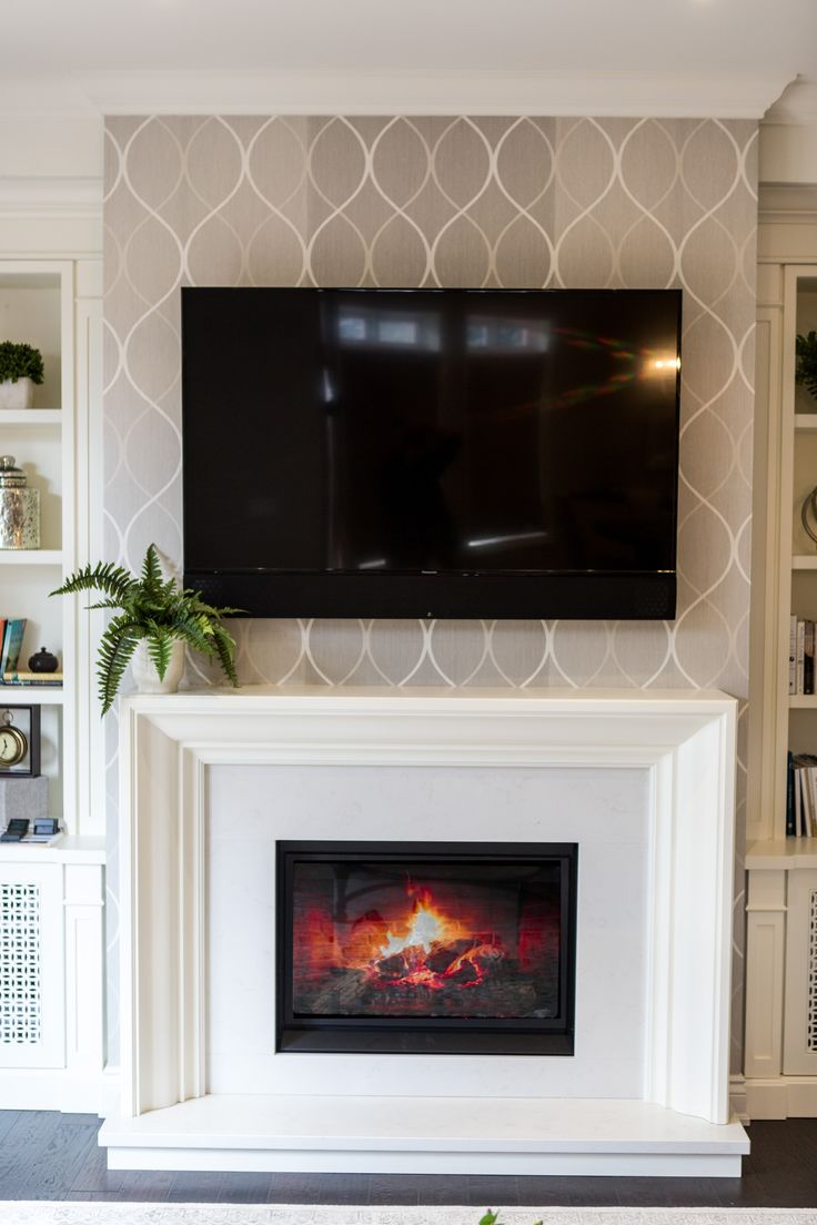 Custom built gas fireplace in the living room #BaeumlerQualityConstruction