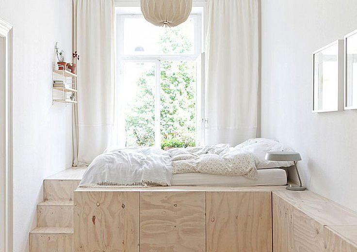 This image of a charming plywood platform bed reminded us of the late Tobias Wong's bed made of a mattress on top of a grouping of file cabinets.  No need