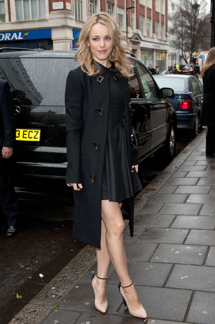 We love a chic coat! Rachel was out and about in London wearing a black mini dress but keeping warm with a pretty black coat. via StyleList | http://aol.it/1nRhhDK