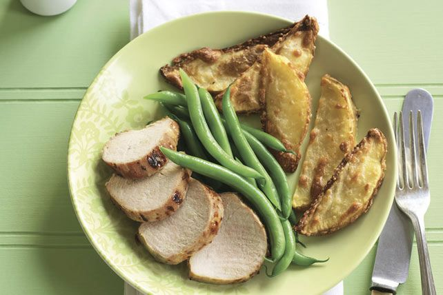 Juicy roast pork slices and crispy Parmesan-potato wedges look like bistro-style fare on your plate. But the prep time for this recipe is just 10 minutes.