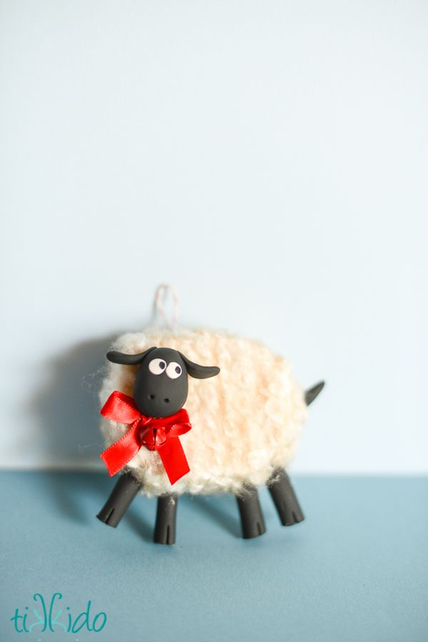 How to make an adorable, fluffy sheep Christmas ornament for your Christmas tree. A little fimo, a little yarn, and a little Styrofoam insulation are all it takes!