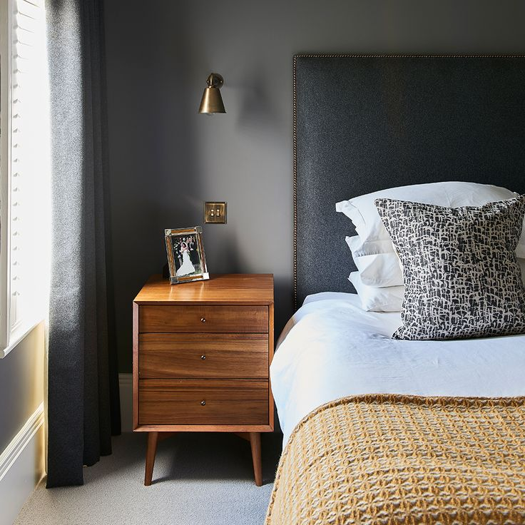 Modern bedroom with muted palette of warm gold and grey