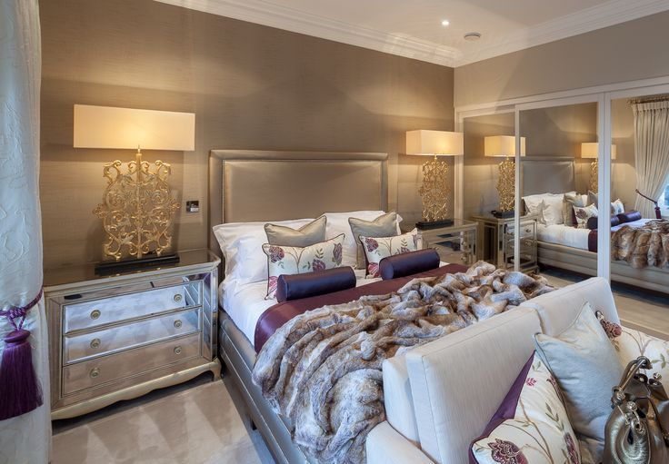classic contemporary master bedroom suite in warm gold colour tones with accents of purple and mulberry designed by www.aji.co.uk