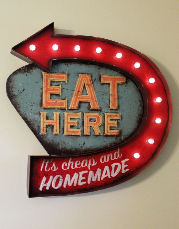 Led light up Eat Here sign. Takes AA batteries.