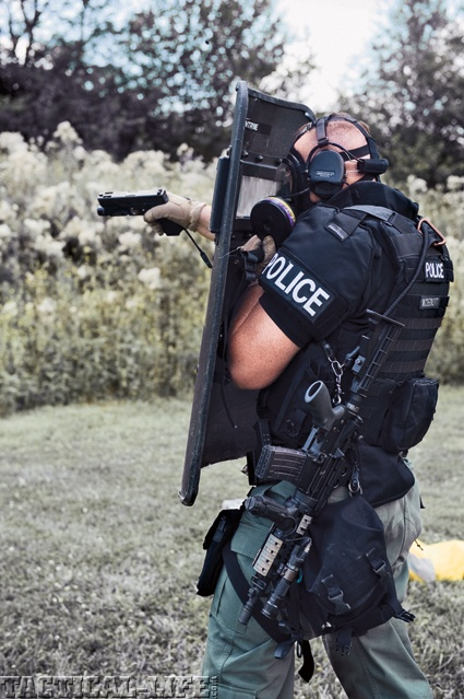 Tactical Police Officer (SWAT) training for his part of the entry line....