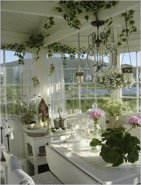 #ShabbyChic #kitchen inspiration - love the plants, exposed beams, crystal chandelier, bell jar with pink flowers, all the windows. Beautiful! ≈√