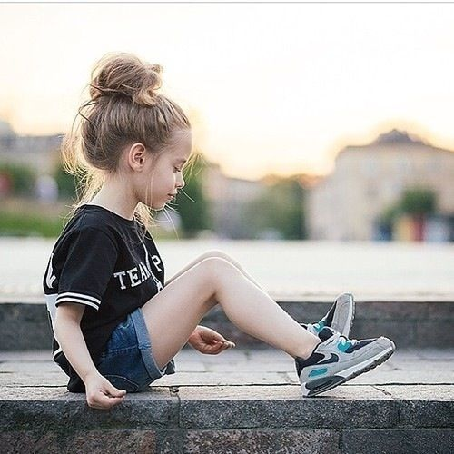 Simply the cutest little one with a top bun and laid back style! Want lol even though the models a little girl