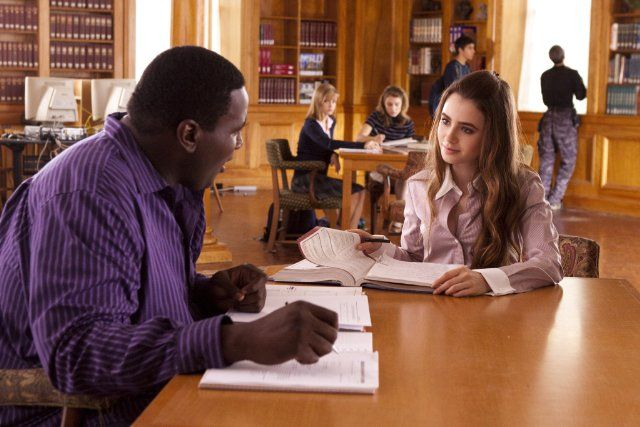 Still of Quinton Aaron and Lily Collins in The Blind Side (2009)