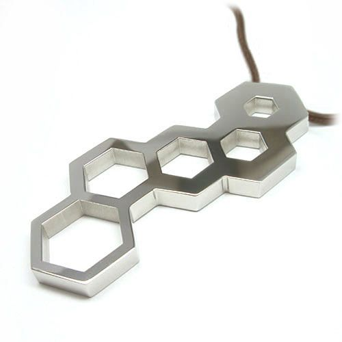 Hex Wrench Pendant - The Hex Wrench Pendant is one handy piece of jewelry since it is also a hex wrench. The holes are sized to a standard bit and they will also fit 8, 10, 12, and 14mm nuts.