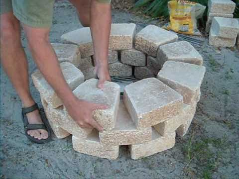 Easy Fire Pit Build I demonstrate how to create an easy and very quick firepit made from materials and items I bought at a Lowe's home improvement center. You can cook on it or just sit around it and tell lies. Post apocolyptic life will not be complete without a firepit to cook your rat on. Campfire safety: http://www.smokeybear.com/campfire-safety.asp