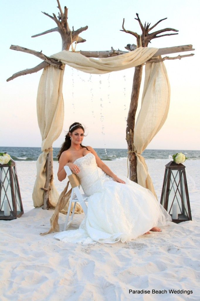 Beautiful beach wedding arch, 2 driftwood tree trunks upside down. could use palm trees for accents as well as the buoys