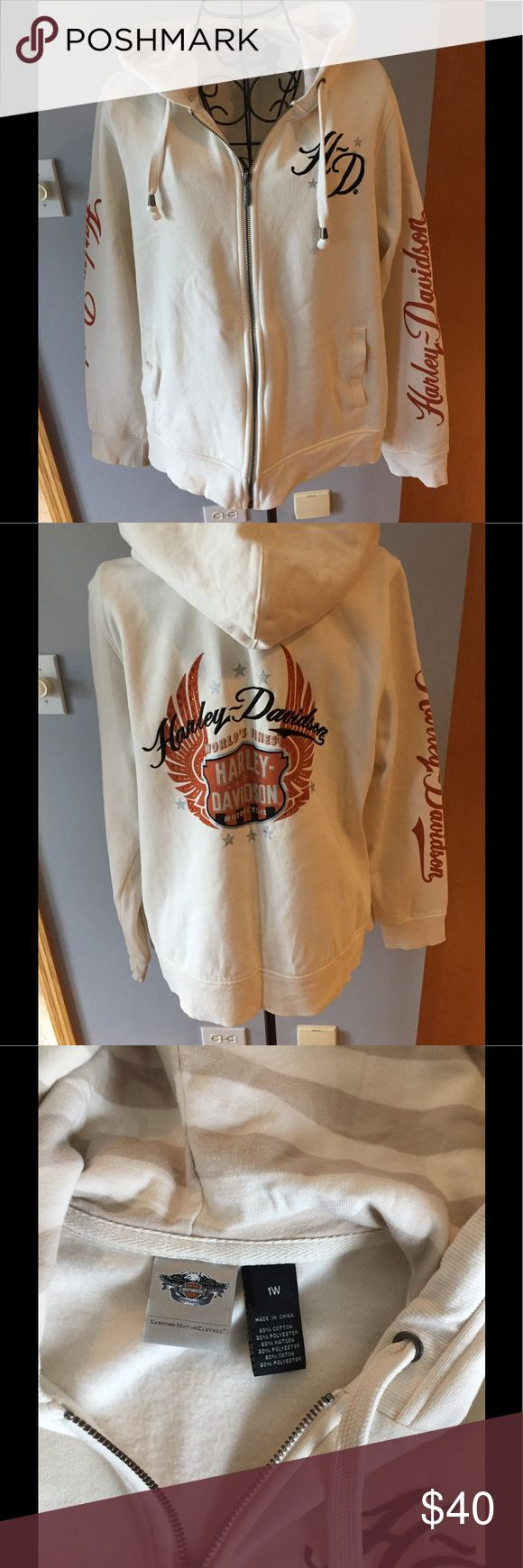 NWOT Harley Davidson Zip Up Sweatshirt NWOT Harley Davidson cream zip up sweatshirt. Re posh. Never worn, purchased NWT,  Cut tags off, washed and line dried. Bling  and embroidered. Striped inside hoodie Harley-Davidson Tops Sweatshirts & Hoodies