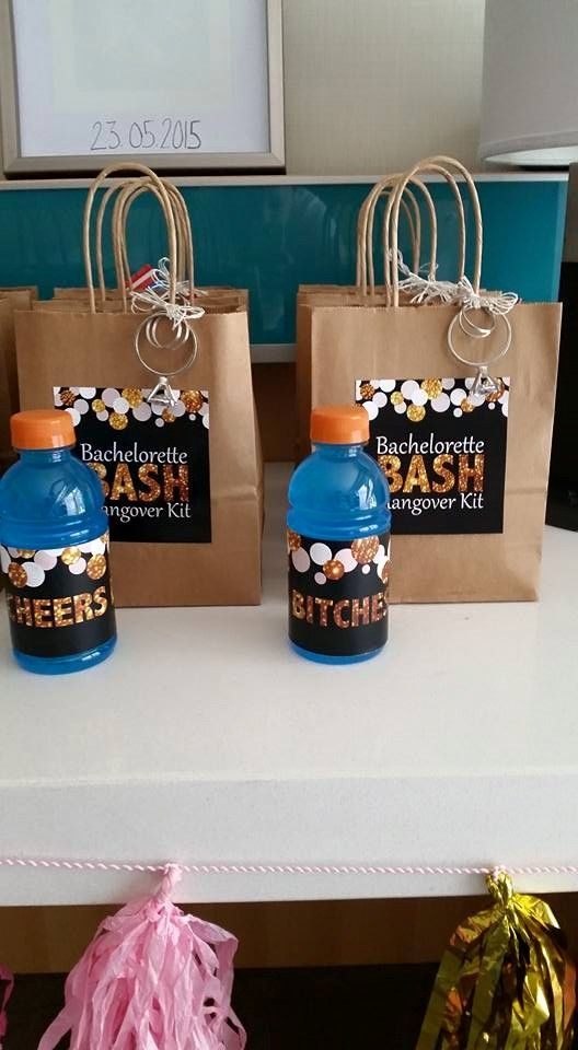 "Bachelorette Bash - Cheers Bitches Themed Bachelorette Party. Custom labels that read ""Natalie's Bachelorette Hangover Kit."" Kraft bags with sticker label and a diamond key chain attached. Gatorade bottles (for the morning after) had a custom label that read ""Cheers Bitches"""