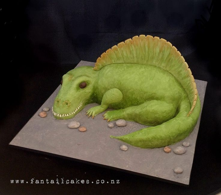 Spinosaurus Cake The birthday boy wanted a scary and mean looking Spinosaurus cake for his fifth birthday.This is my first sculpted cake...