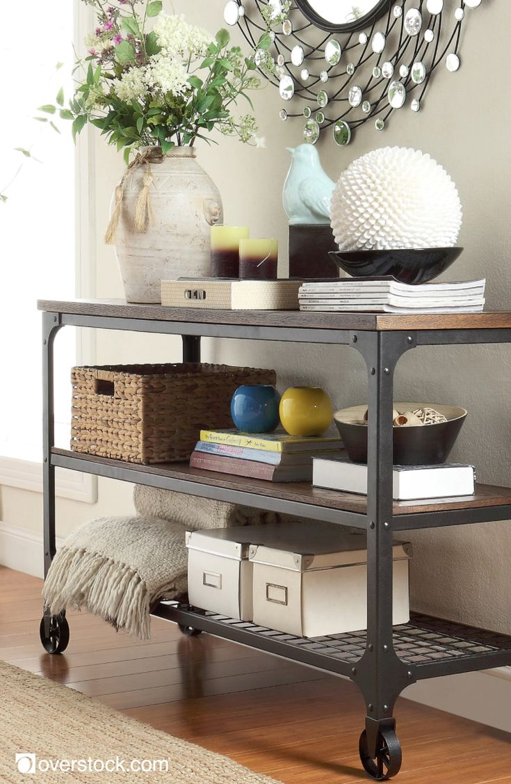 Add an industrial, modern flair to your room with this Nelson TV stand. The