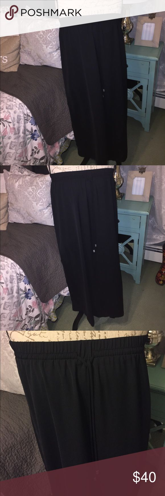 Black Maxi skirt New without tags! Beautiful long black maxi skirt with flattering thick elastic waist band and long drawstring detail. Beautiful dressier fabric that can absolute dressed up or dressed down. Also has two slits to slightly below the knee on each side of the skirt for added comfort and flowiness to the skirt ❤️ Women's Size XXL or 2X . From a smoke free and pet free home fourteenth place Skirts Maxi