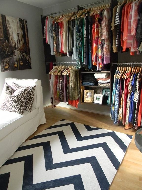 A small bedroom turned into closet/dressing room. This is a great example of an AFFORDABLE/REALISTIC version of a dressing room for a young couple.