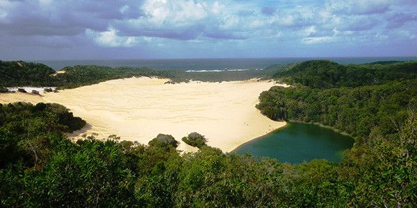 Lake Wabby, Fraser Island, Australia   Located in the Great Sandy National Park on the eastern side of Fraser Island, this freshwater lake is the deepest the island has to offer. The deep green water is bordered by a giant sand dune that is slowly moving into the lake.