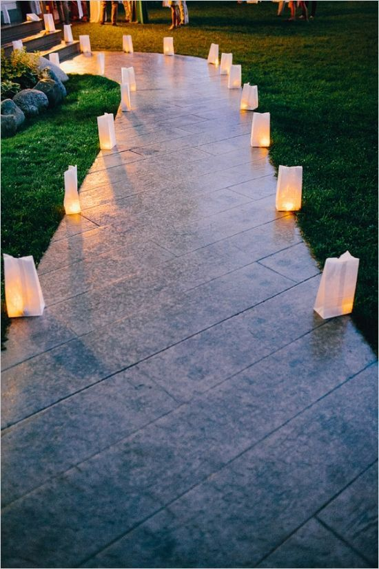 Paper bags as candle holders to line up the path going to the reception area - so romantic #diywedding #weddingdecor #weddingreception #outdoorwedding #wedding