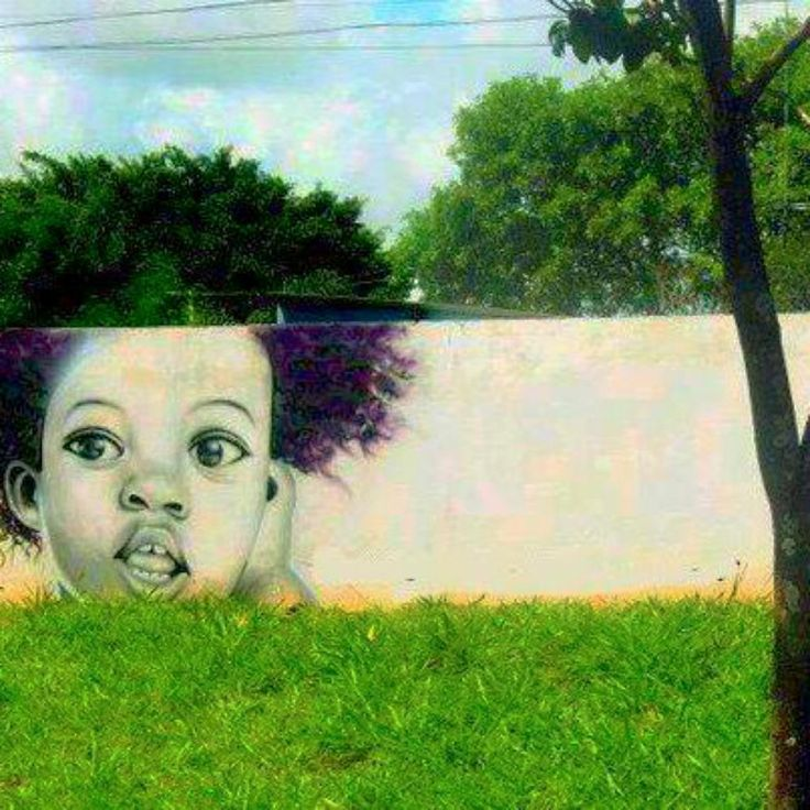 This awesome graffiti incorporates some local plant life into its design. I feel sorry for this kid once the seasons change!